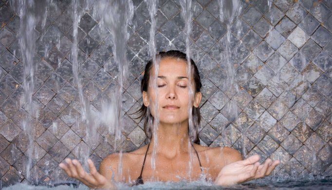Relaxed woman in healing thermal water